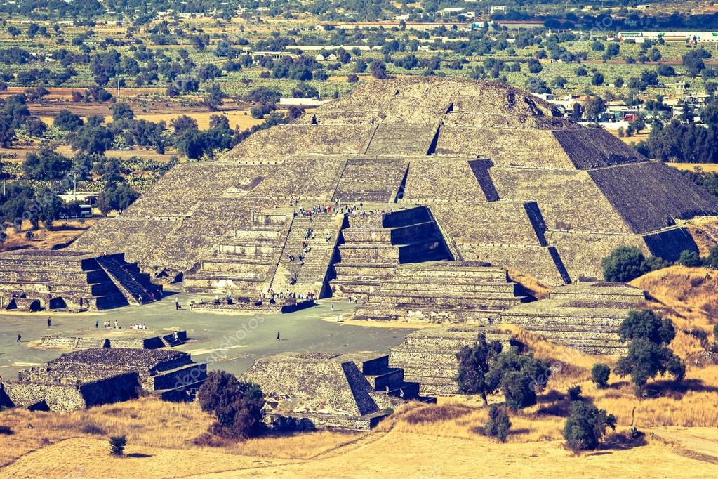 Vintage retro hipster style travel image of Pyramid of the Moon. View from the Pyramid of the Sun. Teotihuacan, Mexico
