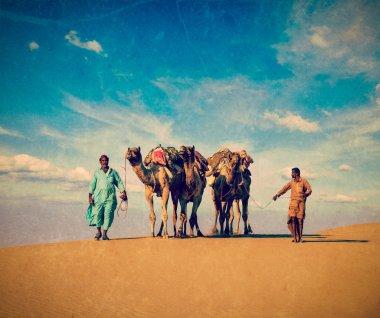 Two cameleers in dunes of Thar desert