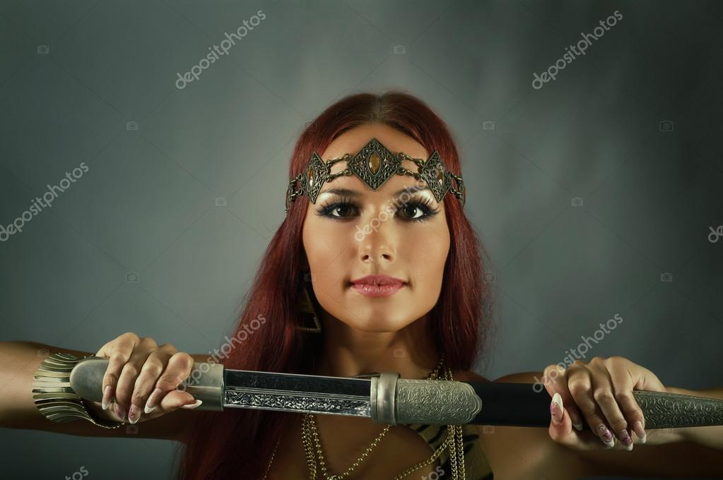 woman holding sword - 1023×680