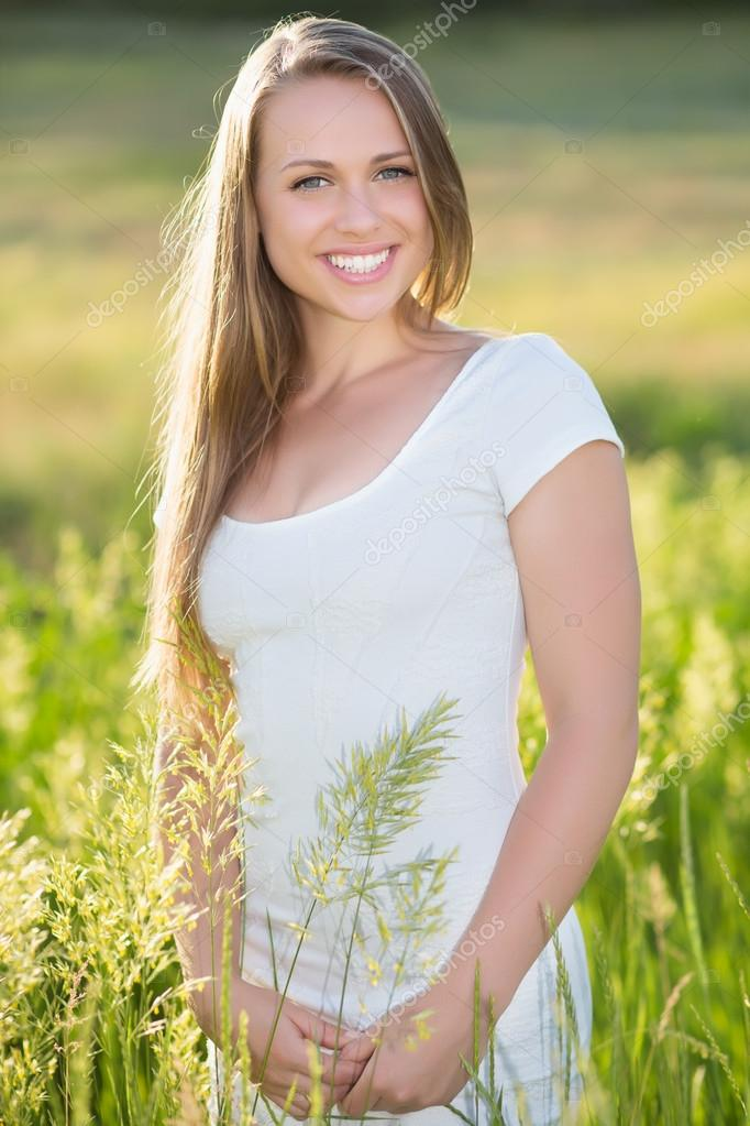 Smiling young blonde on the meadow