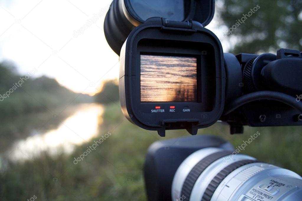 A videocamera filming river