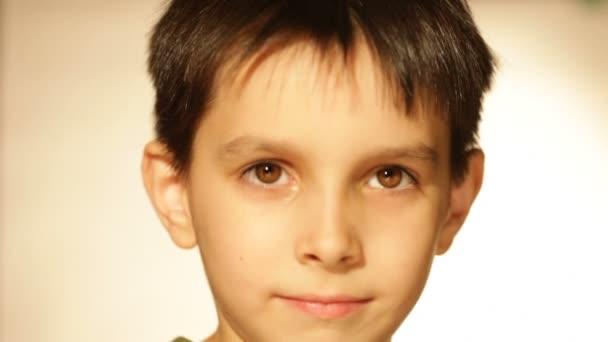 boy playing peekaboo, a portrait