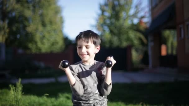 Boy lifting dumbbells