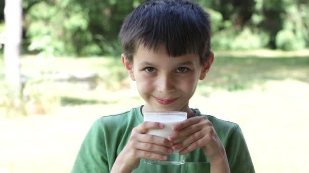 Boy drinks milk