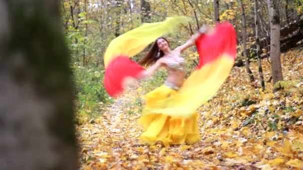 Girl dancing in the autumn park