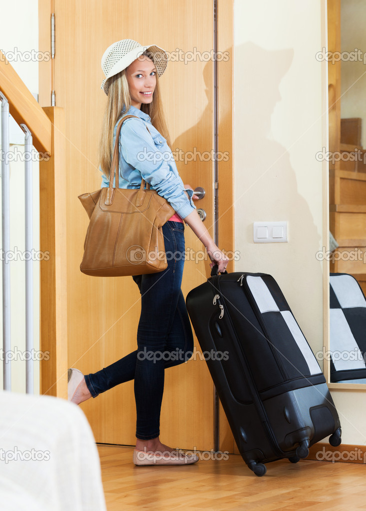 woman leaving with luggage - 645×900