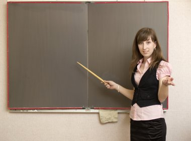 The young woman with a pointer at school boards
