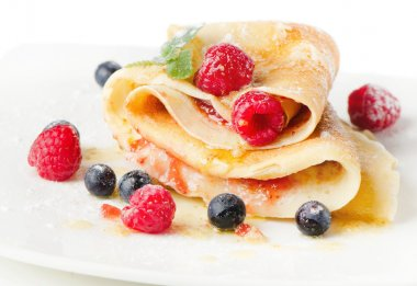 Crepes with berries and mint