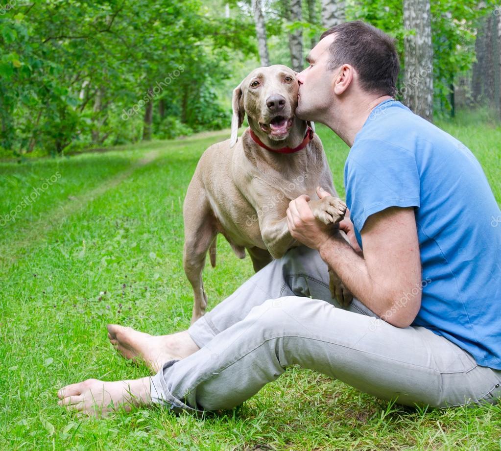 depositphotos_22208971-stock-photo-happy-man-and-his-dog.jpg