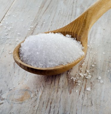 sea salt in wooden spoon