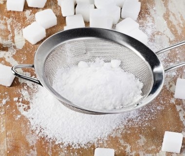 Powdered sugar in a metal sieve