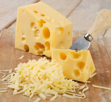 Grated Cheese on a wooden table. Selective focus stock vector