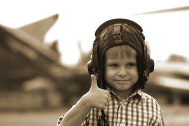 Little boy in flight helmet