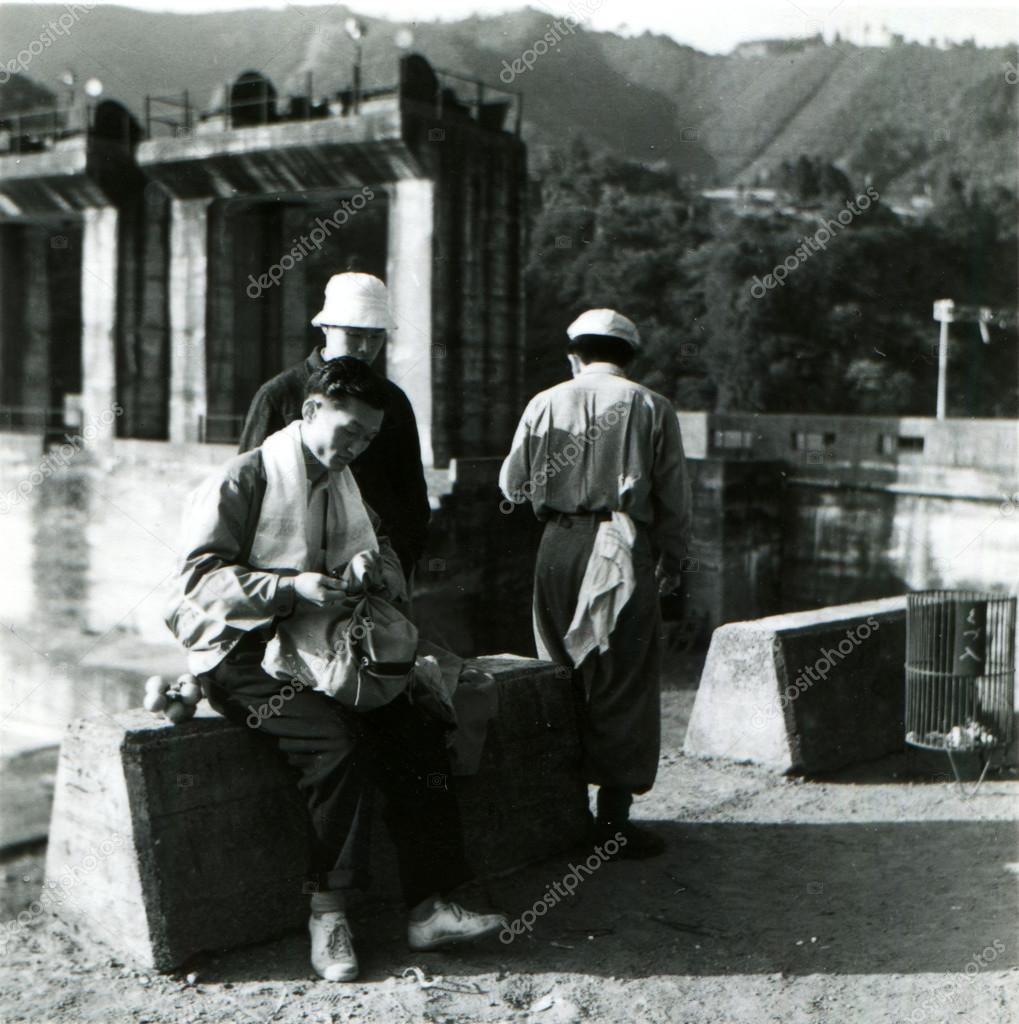 Three Man On The Backdrop Of A Railway Bridge Under