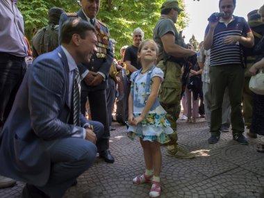 Oleg Tsarev talking to a little girl