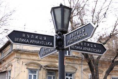 Vintage lantern with street signs