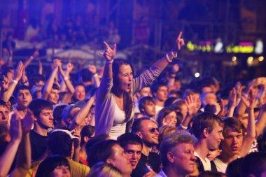 People dance during rock concert