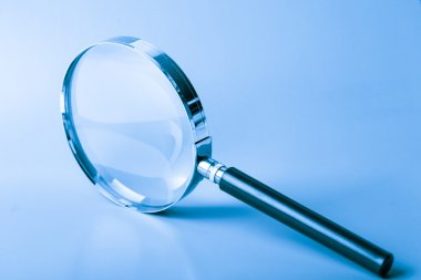 Magnifier on blue