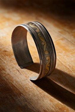 Vintage silver bracelet on wood background