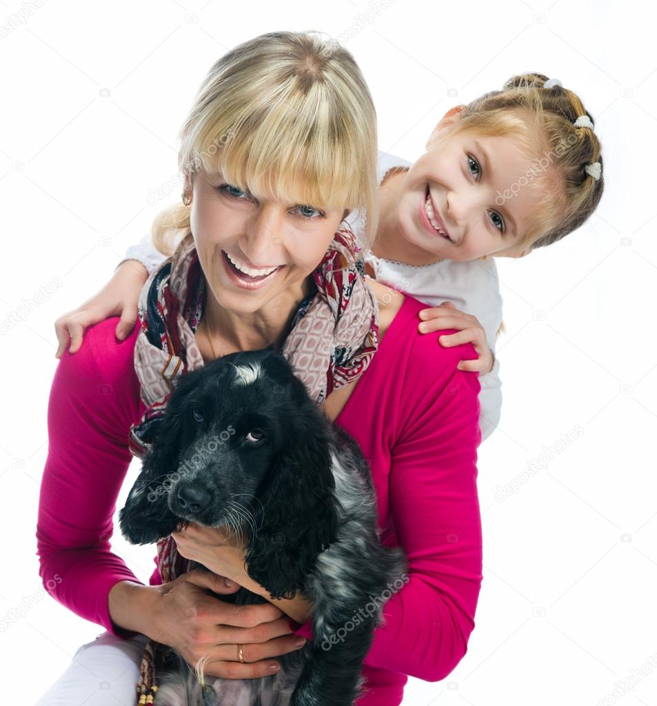 Young woman with her daughter and dog