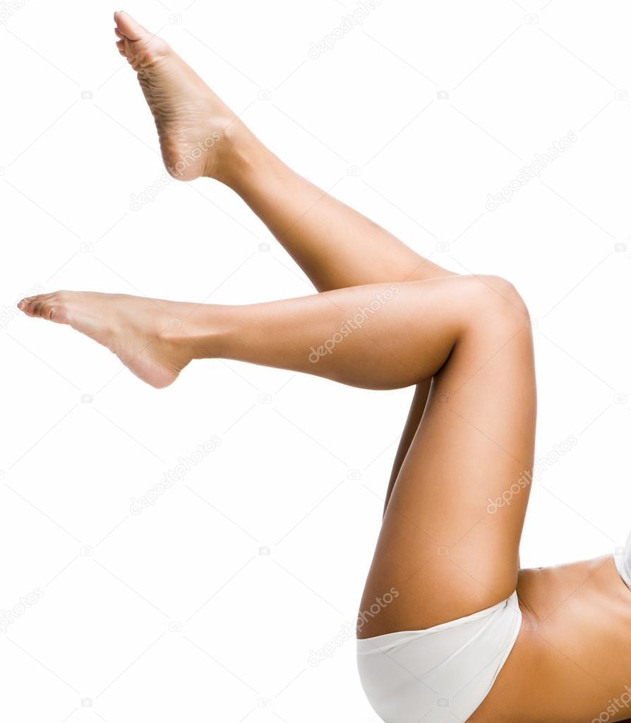Hispanic Young Woman Applying Moisturizing Lotion Onto Her