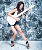 Gyönyörű rock énekes, gitár