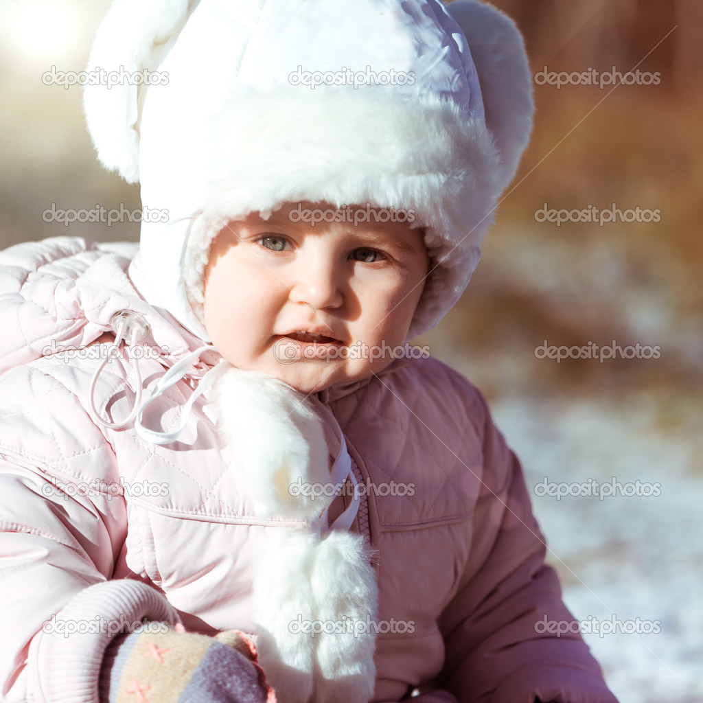 little girl enjoys the arrival of winter