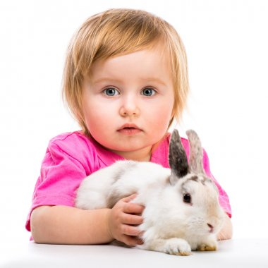 baby girl  with her small rabbits