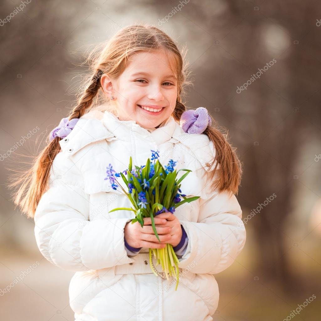 little girl with a snowdrops