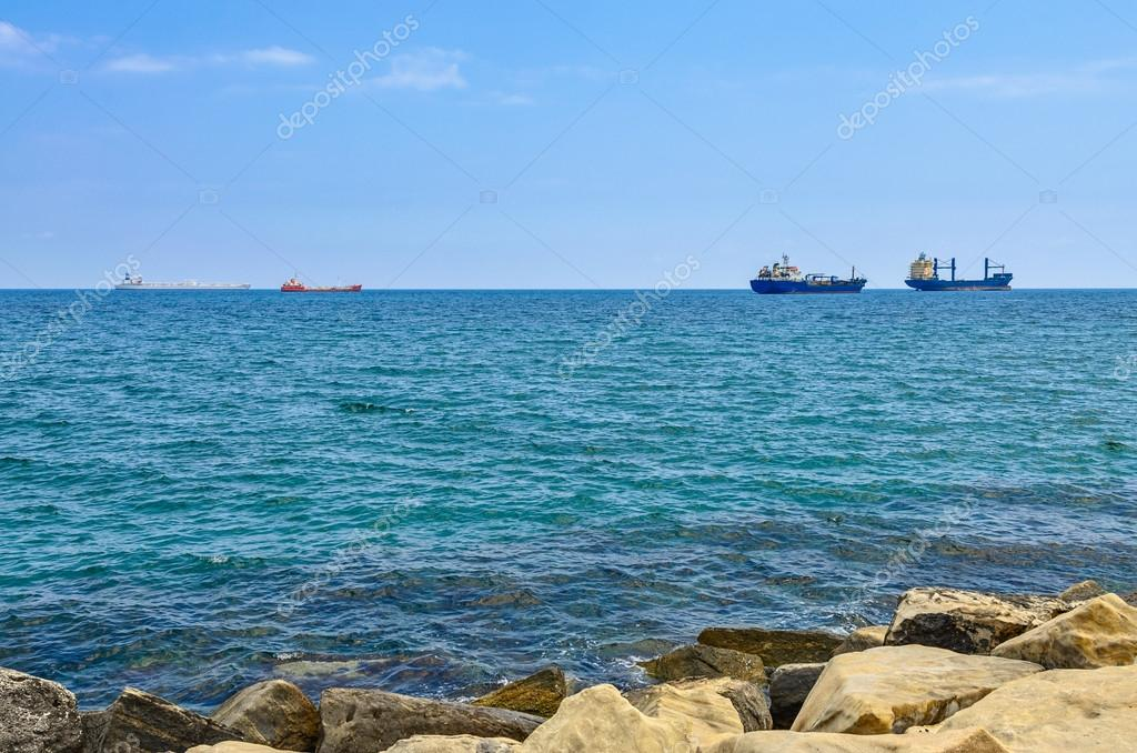 Cargo ships on horizon