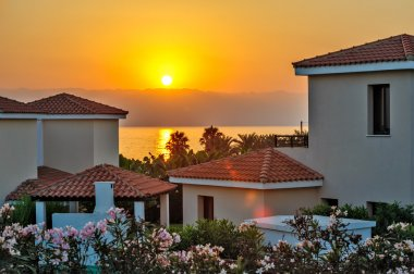 Sunset over holiday beach villas
