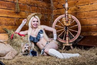 Young sexy girl in underwear sit in the barn with hay