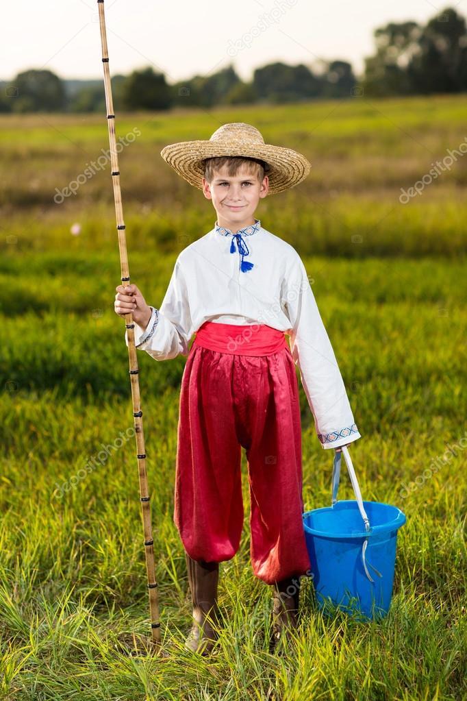 Young cute boy fishing in a river