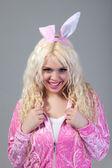 Fotografie Woman wearing a pink rabbit costume