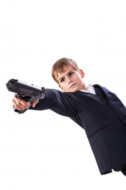 Young boy with gun