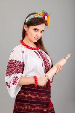 Housewife with rolling pin. Woman wears Ukrainian national dress