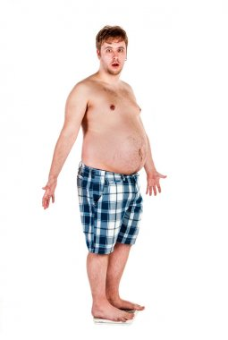 Overweight, fat man and scales.