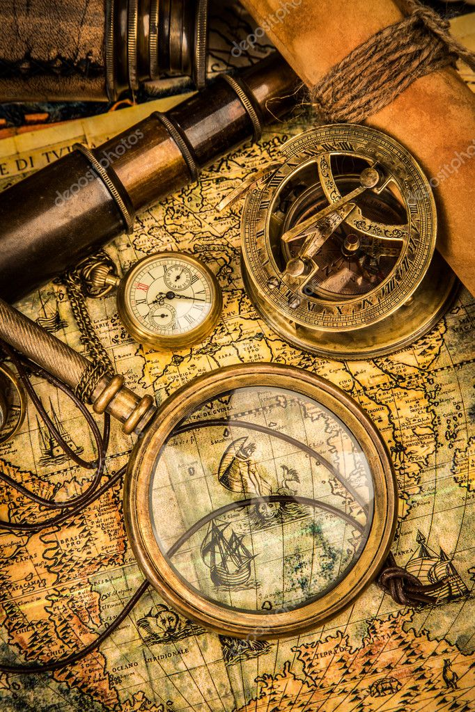 map magnifying glass astrolabe compass