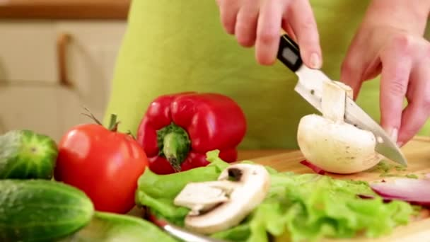 Womans hands cutting vegetables