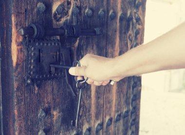Man opens lock