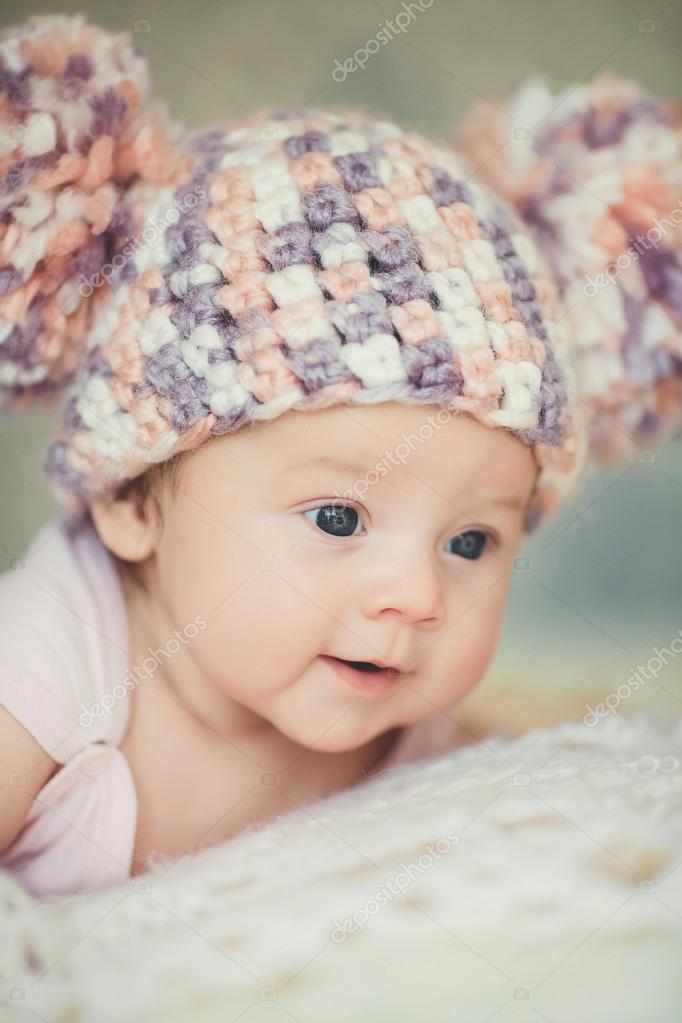 Cute newborn baby girl in knitted cap with bubonic stock photo