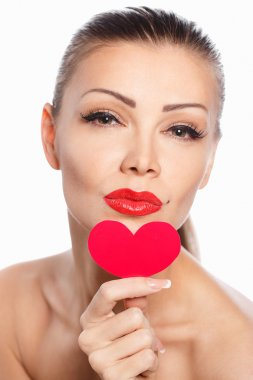 Portrait of Beautiful gorgeous smiling woman with glamour bright makeup and red heart in hand