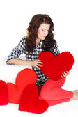 Valentines Day. Beautiful smiling woman with a gift in the form of heart in his hands