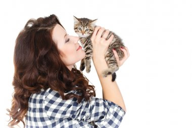 Portrait of a Young pretty woman holding her lovely little cat isolated on a white background