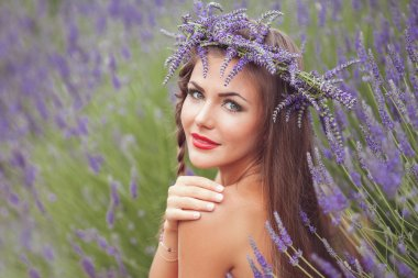 Portrait of young woman in lavender wreath. Fashion, Beauty