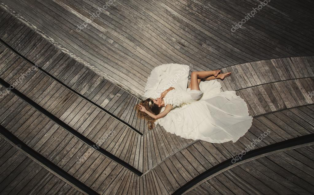 Bride in wedding dress relaxing and having fun on the tropical island of Maldives