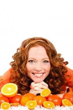 Portrait of attractive caucasian smiling woman isolated on white studio shot with oranges