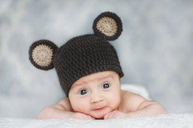 Cute newborn baby boy in a hat