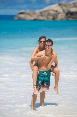 Loving couple having fun on the beach of the ocean.