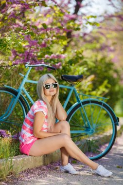 Spring walk  Romantic portrait of a girl with a bicycle